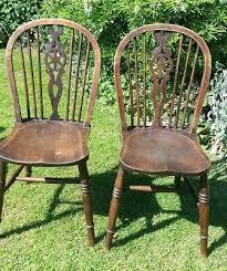 2 vintage wooden wheelback farmhouse chairs