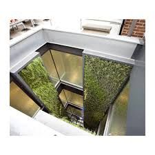artificial green wall systems in a lightwell