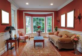 Good Red Living Room Color With Bay Windows About Window Ideas