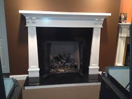 this fireplace hearth is wood with a black granite top