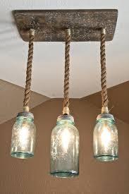 mason jar triple pendant light with vintage blue mason jars and