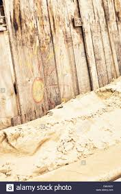 wood fence drawing. Vintage Wooden Fence On Sandy Beach With Cute Drawing Of A Sun. Wood