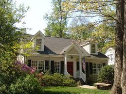 example of a small classic two story brick exterior home design in atlanta