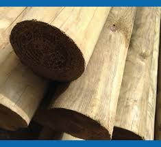 how to install round wood fence posts