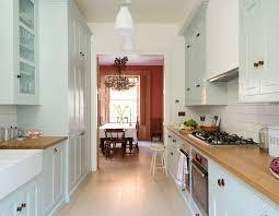 devol classic pimlico kitchen backsplash is white subway tile counters are wood cabinets a pale blue