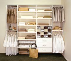 interior floating white wooden closet with white wooden drawer and white wooden board shelves also