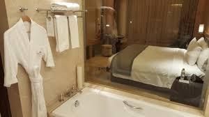 galaxy hotel bathroom with see through panel beside bath tub