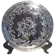 footed clear glass cake plate with impressed flowers