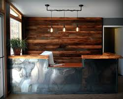 rustic wood wall pipe pendant light reclaimed metal natural edge wood reception hotel reception desk
