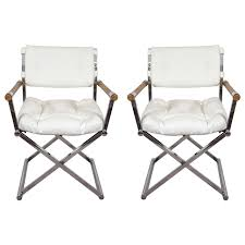 a midcentury pair of white leather director s chairs attributed to milo baughman for