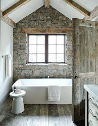 stone accent wall ideas faux stone wall and weathered wood on the floor make this bathroom cabin like