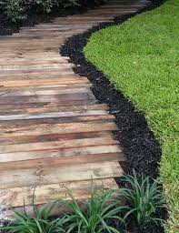 the previous wood walkway but with neater edges and a wider path for a less rustic look source unknown from