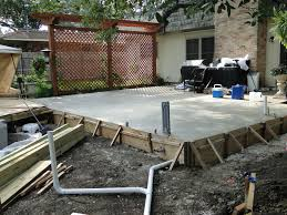 patio addition after the 550 square foot pour replace wooden walkway with concrete