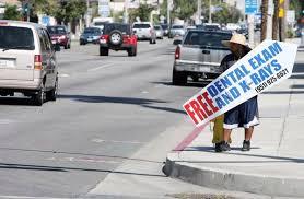 sign twirler hemet city to crack down on handheld advertising signs