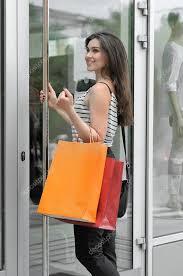 smiling girl walks into a glass door stock photo