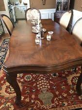 drexel herie dining table with 2 arm and 4 side chairs