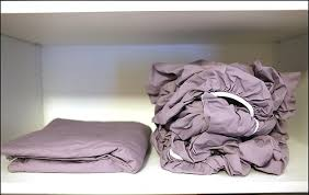 fold fitted sheet with this trick itll be super easy to fold a fitted sheet we had