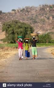 girls carrying baskets Andhra Pradesh South India Stock Photo ...