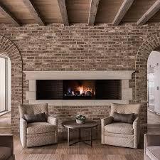 living room carolina design associates: carolina design associates middot long and narrow wall fireplace surrounded by bricks