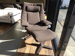 image of natuzzi revive casual swivel chair footstool brown fabric with natuzzi leather swivel chair