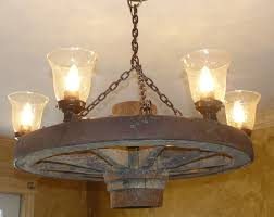 items similar vintage wagon wheel upcycled into chandelier