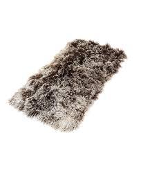 tibetan sheepskin rug brown with white tips