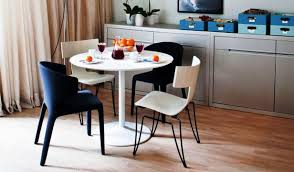 mismatched dining chairs look chic and grab attention