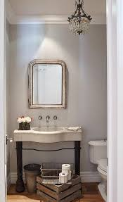 gray powder room with silver beaded mirror
