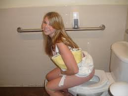 Girls peeing in the toilet