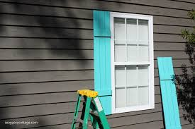 installing new diy board and batten shutters on exterior windows