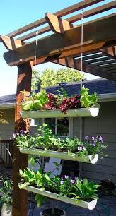 outdoor gardening. Hanging Gutter Garden For Your Outdoor Space Is A Simple DIY Idea Gardening E
