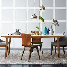 white wood contrast scandinavian style modern dining table with angled legs warm and cool at the same time
