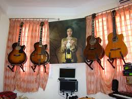 how to hang guitars without wall hangers