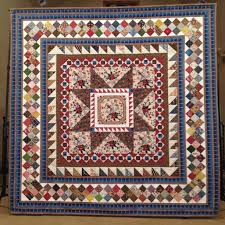 Gallery of quilts by Jennifer Perkins Quilts & 2015 Blue Ribbon at Omaha Quilt Show 2015 Juried into AQS Quilt Show in Des  Moines 2016 Juried into AQS Quilt Show in Paducah Adamdwight.com