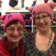 Thousands of women knit pink pussy hats to wear at Trump protest.