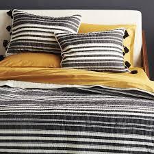 koti black ivory striped pom pom bedding