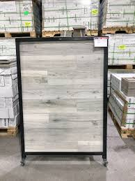 i decided on a wood look tile at first i was drawn to the more gray colored planks but with the help of kristi i redirected my attention to a more