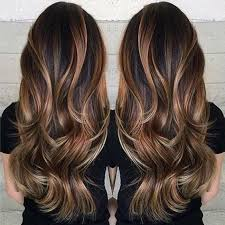 bold bage highlights in a warm caramel shade bring a dramatic color contrast when paired with a dark brown base color if you love high drama hair color