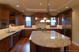 Traditional Medium Wood Brown Kitchen Cabinets from Kitchen Design