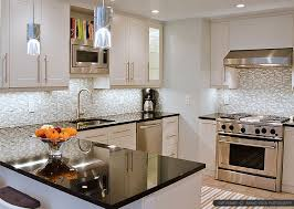 black countertop white mosaic backsplash tile