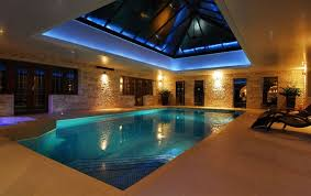 indoor swimming pool lighting. i would definitely have an indoor swimming pool love this roof aspect too lighting g
