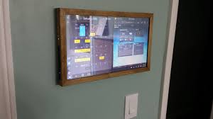 picture of touchscreen wall mounted family sync home control panel