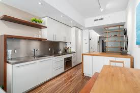 View in gallery Smart and modern kitchen inside the small Vancouver  apartment