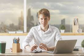 european cup office coffee. Portrait Of European Guy Working On Project At Modern Desk With Laptop, Paperwork, Supplies Cup Office Coffee I