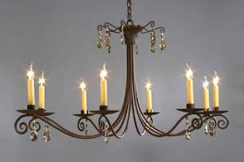 the santa fe is a strong substantial chandelier and features hand forged scrolls it s design is pure and uncomplicated in keeping with the classic
