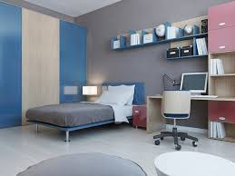 rather than the room having completely covered in grey it has a pop of blue throughout the bed frame and storage cubes on the shelf are a blue jay color