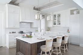 Painted White Kitchen With Dark Wood Island Crystal Cabinets
