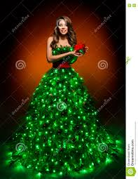 Girl Baby Blonde In A Red Dress Next To The Christmas Tree Stand Girls Christmas Tree Dress