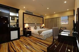 a bed or beds in a room at al muhaidab residence al ahsa