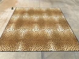 faux leopard pattern synthetic area rug photo 1